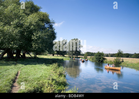 people Boating on the river Stour between The historic village of Dedham and Flatford in Constable country - Stock Photo