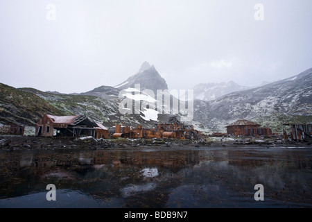 Prince Olav abandoned whaling station in snowstorm South Georgia Antarctica - Stock Photo