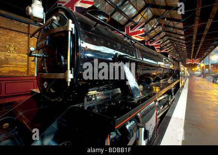 An old steam locomotive in the National Railway Museum in York - Stock Photo