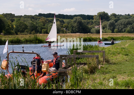 People sailing on the River Stour at Friar's Meadow in Sudbury, Suffolk, England - Stock Photo