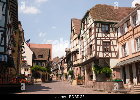 Riquewihr Alsace Haut Rhin France Street scene with old timbered buildings in picturesque medieval town on Alsatian - Stock Photo