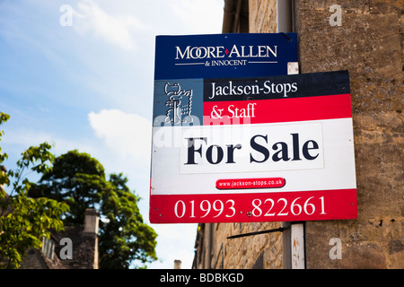 For Sale sign on a house in England UK - Stock Photo