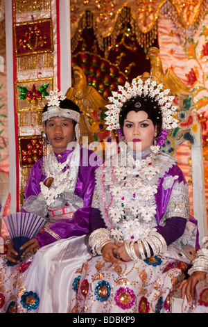 Indonesia Sulawesi Sidereng village bride and groom at muslim marriage celebration - Stock Photo