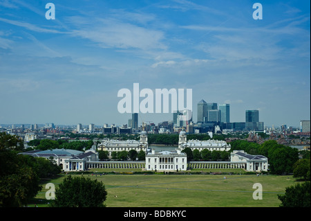 View from Greenwich hill to Canary Wharf and London with the Maritime Museum in the foreground - Stock Photo