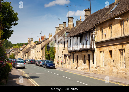 Row of Cotswold stone terraced houses in Northleach, Gloucestershire, UK - Stock Photo