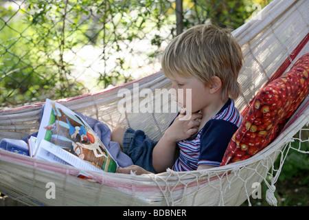 A boy in a hammock - Stock Photo