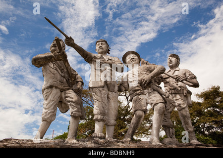 Indonesia Sulawesi Sidereng muslim cemetery badly sculpted war memorial - Stock Photo