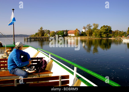 View of the Fraueninsel Island from the Passenger Ferry Ludwig II Chiemsee Chiemgau Bavaria Germany - Stock Photo