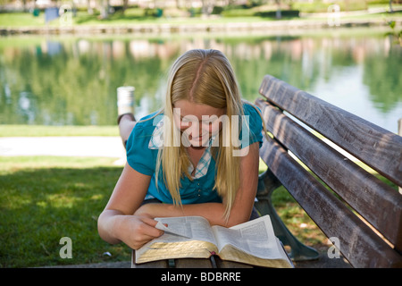 young person people Tween tweens 11-13 year old olds Caucasian Junior high girl reading the Bible meditating reflecting - Stock Photo