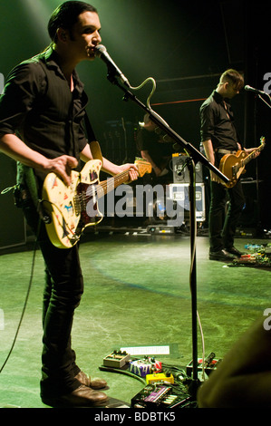 Rock band Placebo playing live in London in 2009 - Stock Photo