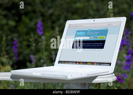 Laptop showing social networking Twitter splash screen page - Stock Photo