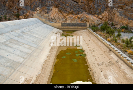 Dried out dam  in the River bed Wadi Ghul Al Dakhiliyah region Oman - Stock Photo