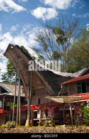Indonesia Sulawesi Tana Toraja Bebo satellite TV dish outside tongkonan house in family compound - Stock Photo
