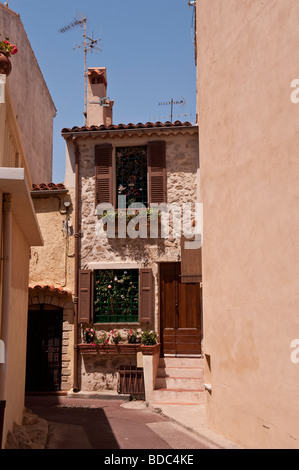 House in a side street in old Antibes South of France - Stock Photo