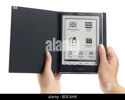 Woman opening Sony Reader e-book - Stock Photo