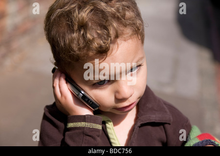 toddler boy using a mobile phone - Stock Photo