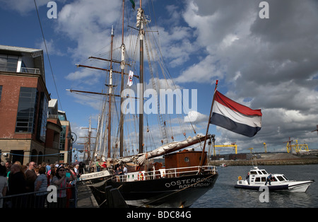 dutch tall ship oostershelde berthed on the river lagan with titanic quarter in the background - Stock Photo
