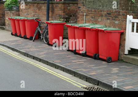 Wheelie bins waiting for collection in a street in Stratford-Upon-Avon, UK - Stock Photo