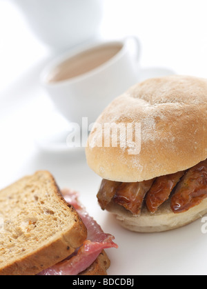 sausage bap and bacon sandwich - Stock Photo