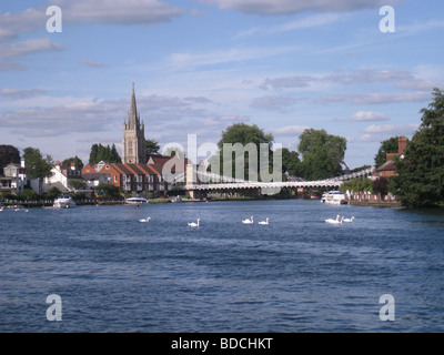HENLEY-ON-THAMES, England   with swans and leisure boats on the River Thames - Stock Photo