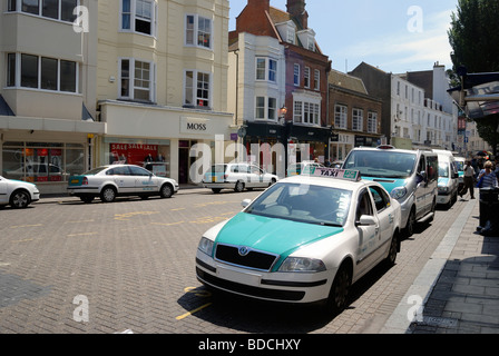Taxis queuing for a fare in central Brighton - Stock Photo