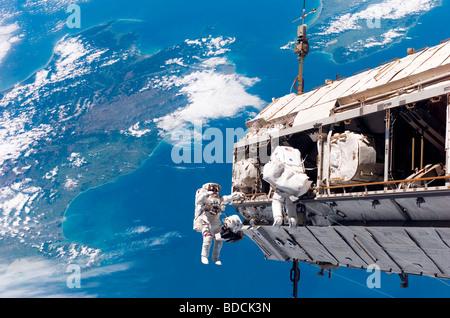 NASA Astronauts working on International Space Station - Stock Photo