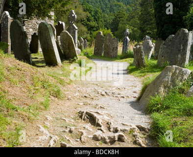 Gravestones lining a path at Glendalough in County Wicklow, Republic of Ireland Summer 2009 - Stock Photo