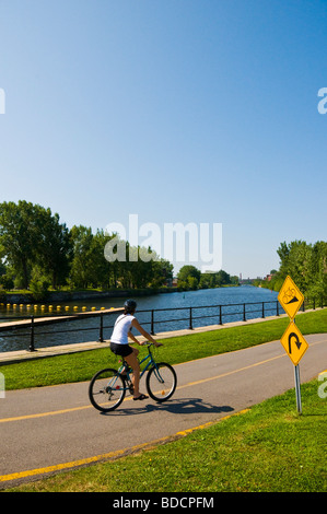 Cycling along Canal Lachine in Montreal Canada - Stock Photo