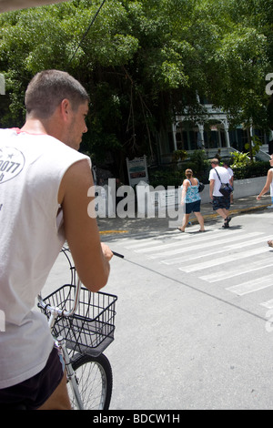 Pedicab driver coming up to Hemingway house in Key West - Stock Photo