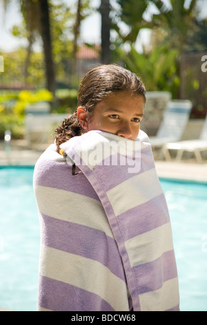 11 12 13 year years old child children Junior high age hispanic/caucasian girl wrapped in towel after swimming in - Stock Photo