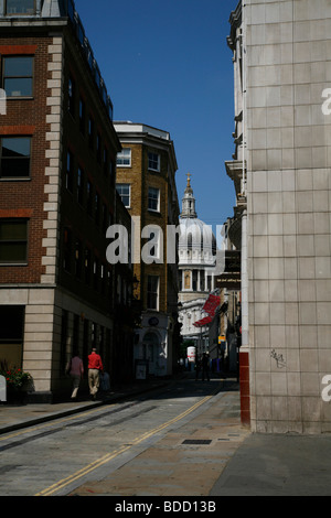 Looking up Watling Street to a glimpse of St Paul's Cathedral, City of London, UK - Stock Photo