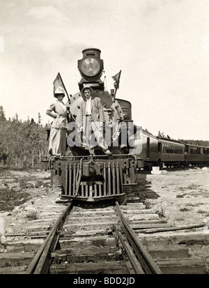 Couple Standing on Front of Locomotive - Stock Photo
