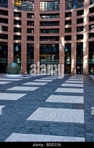 Paved entrance perspective to the european parliament building Strasbourg France - Stock Photo