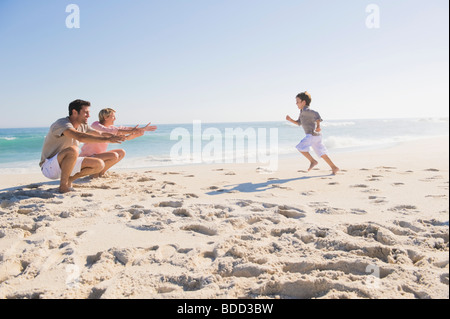Family enjoying vacations on the beach - Stock Photo