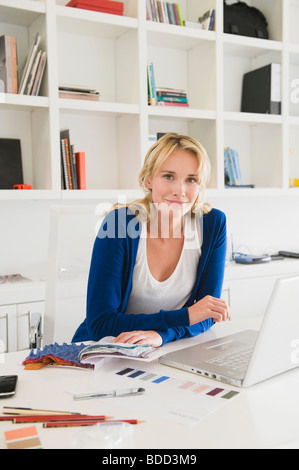 Businesswoman choosing color swatches - Stock Photo