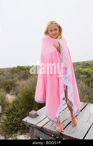 Girl standing on a boardwalk - Stock Photo