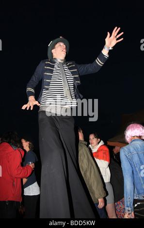 Drunken man on Stilts at Glastonbury festival 2009 - Stock Photo