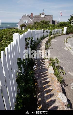 White picket fence along the beach, residential neighborhood, Hyannis, Massachusetts - Stock Photo
