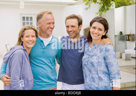 Two couples smiling - Stock Photo