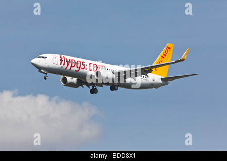A Pegasus Boeing 737 series 800 aircraft on final approach - Stock Photo