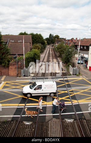 Pedestrians and a van on a railway level crossing in Datchet, Berkshire, UK. - Stock Photo