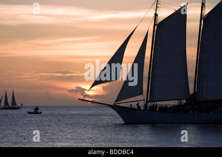 Boats passing through Key West sunset - Stock Photo