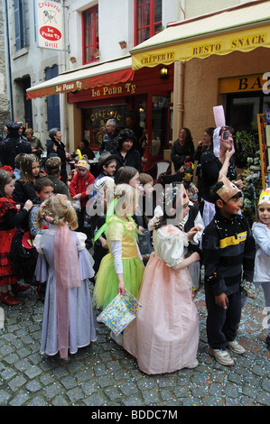 A parade of school children in Paimpol in Brittany - Stock Photo