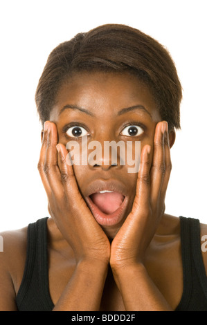Studio portrait of an attractive young African woman looking shocked against a pure white (255) background. - Stock Photo