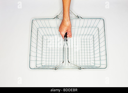 women holding a wire shopping basket - Stock Photo
