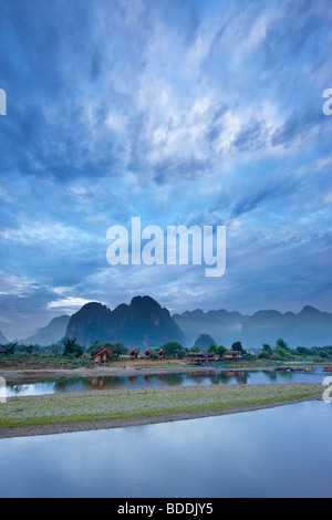 dawn over the mountains and Nam Song River at Vang Vieng, Laos - Stock Photo