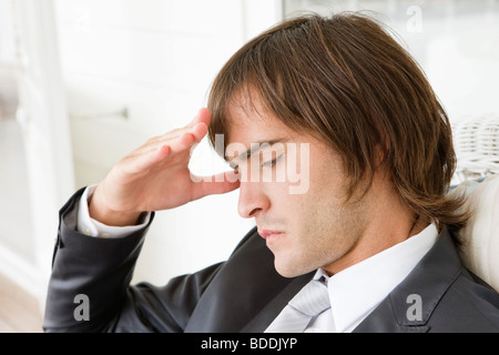 Close-up of a man suffering from a headache - Stock Photo