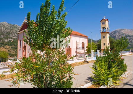Church with separate bell tower in the rural village of Agios Nikolaos on the Greek island of Kefalonia Greece GR - Stock Photo