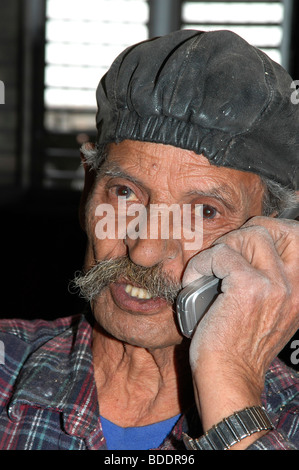 China, Chinese man talks on a cell phone - Stock Photo