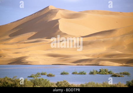 The huge dunes of Erg Chebbi, Merzouga. in the Sahara desert of southern Morocco. - Stock Photo